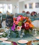 bright colored flowers centerpiece beach wedding