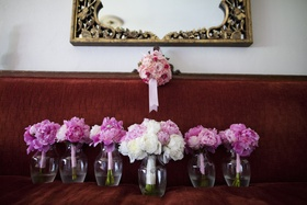 Bride's bouquet of pastel pink & white peonies with bridesmaid bright magenta peonies bouquets