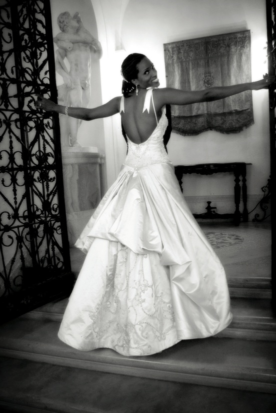 Black and white photo of ball gown wedding dress