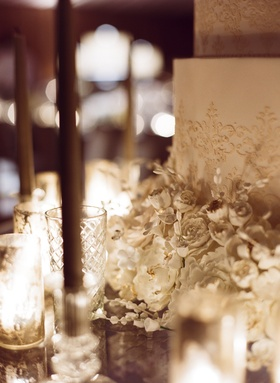 Close up photo of white wedding cake with flower details