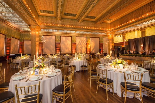 Wedding reception gold ballroom art institute of chicago round table gold chairs black cushions