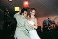 Bride and groom on dancing in reception tent