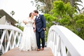 bride in allure ball gown, groom in navy joseph abboud suit kiss on bridge over venice canals