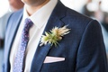 air plant wedding boutonniere on navy blue suit jacket lapel pattern tie