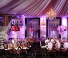 wedding reception designed by lily v events bright purple lighting drapery chandelier metallic gold