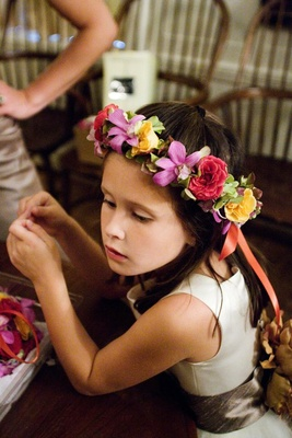 Colorful flower crown on young brunette flower girl