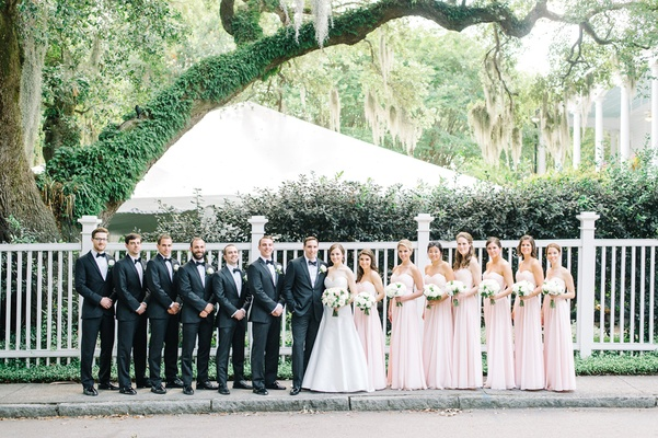 couple bridal party southern estate venue groomsmen bridesmaids classic wedding blush light black