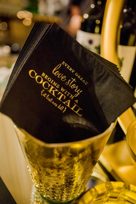 personalized cocktail napkins with gold writing on black