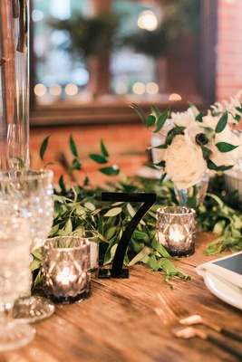 Wood wedding reception table with candle votive cut crystal glassware black table number cut out
