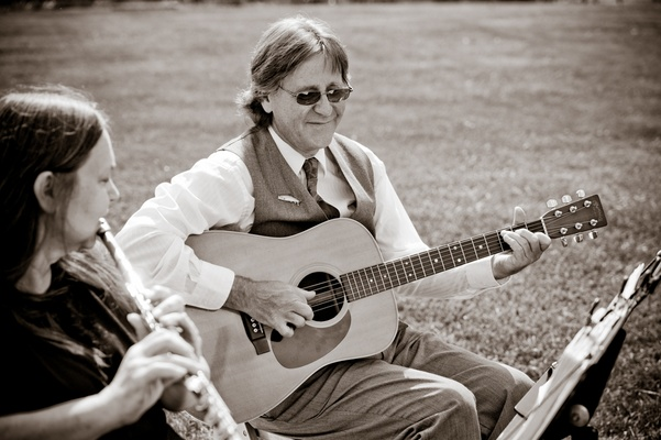Black and white photo of acoustic guitarist and flute