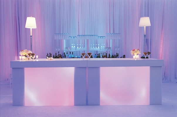 White drink station with pink and purple lighting