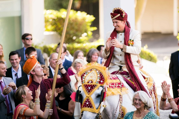 Indian wedding tradition groom in sherwani and turban on horse for Baraat in Los Angeles