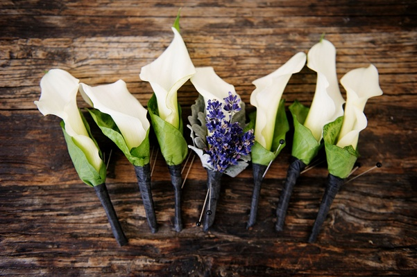 Groomsmen boutonniere white calla lily with green casing purple lavender for groom