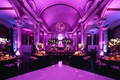 vibiana wedding reception with purple uplighting and monogram in projected light at the top