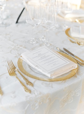 wedding reception embroidered ivory linen gold rim charger plate gold flatware dinner menu napkin