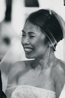 Black and white image of bride at ceremony