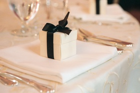 Square box tied with satin ribbon