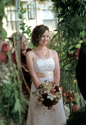 Textured wedding dress with jewelry and flowers