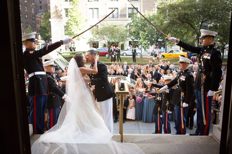 Bride and groom kiss outside church with Marines