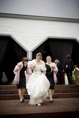 bridesmaids wearing black dresses and pink pashminas