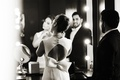 Black and white photo of elegant keyhole back wedding dress