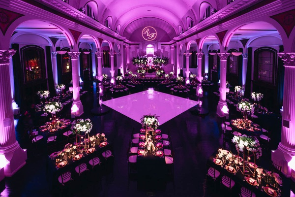 wedding reception at vibiana ballroom filled with purple uplighting