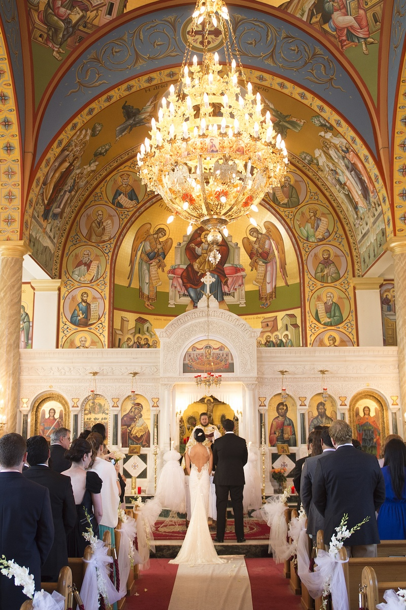 Ceremony dcor photos ceremony at ascension greek orthodox church bride in inbal dror dress and groom in tuxedo at altar of ascension greek orthodox church junglespirit Image collections
