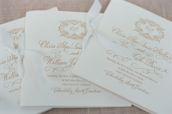 White ceremony booklets with gold lettering