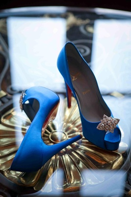 Bride's royal blue Louboutin peep-toe heels with rhinestone accents