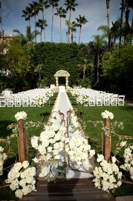 Floral-embellished gate and wedding canopy