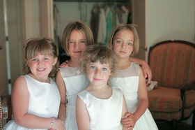 Little blonde girls with blue eyes and ivory gowns