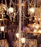 Close up photo of crystal strands and candles on centerpiece