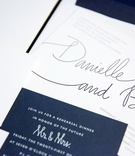 Modern calligraphy wedding invitation white grey script and navy blue stationery