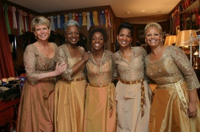 Bridesmaids in golden and copper Bob Mackie dresses