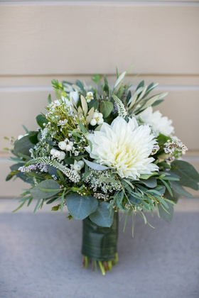 bouquet with white flower and green leaves