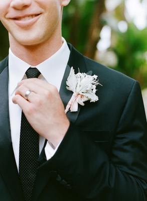 Groom wearing polka dot tie and dusty miller