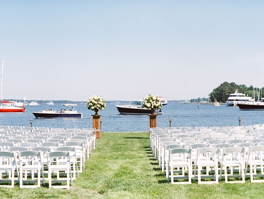 Boats along river at outdoor wedding grass lawn flower arrangements maryland venue river