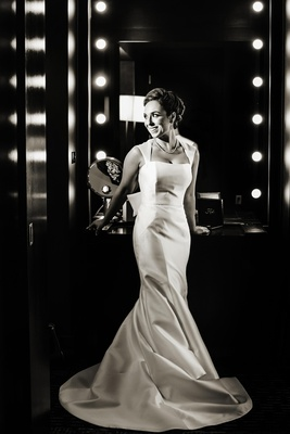 Black and white picture of bride with Queen Anne neckline