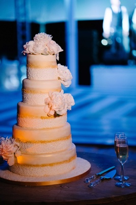 Five layer wedding cake with gold details and sugar flower peony peonies flowers on tiers