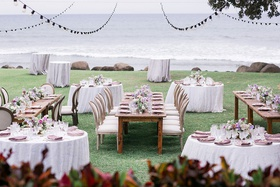 wedding reception hawaii plantation lawn long wood table round purple table patio lights overhead