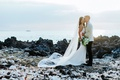 wedding portrait couple photo on lava rocks big island hawaii waimea venue crepe dress long veil