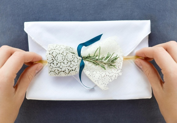 Linen handkerchief invitations and lace-wrapped gifts
