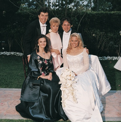 Bride sits with mother and groom's family