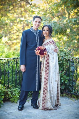 Bride and groom in traditional Sri Lankan wedding outfits