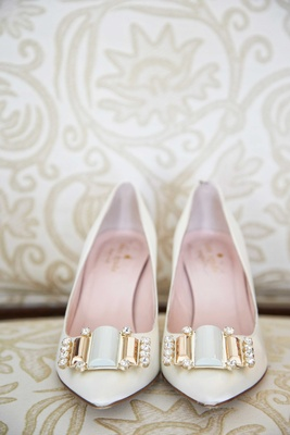 Pointed toe Kate Spade shoes with gold rhinestone white buckle on couch at Ritz Carlton hotel