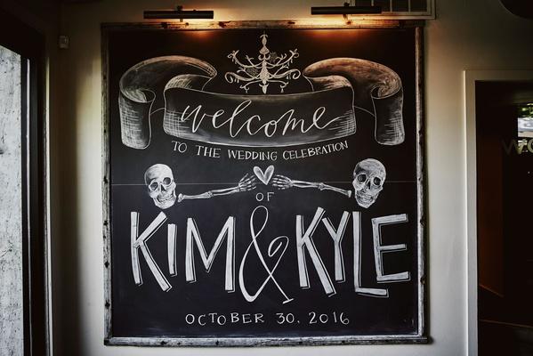 chalkboard wedding sign skull skeleton design halloween wedding weekend