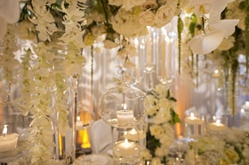tea light candle in suspended glass orb, cascading orchids