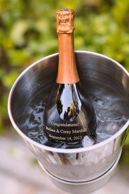 Champagne bottle with a congratulations message for bride and groom in ice bucket