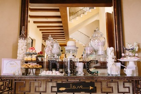 """wedding sweets table with black marquee initials and sign saying """"love"""""""
