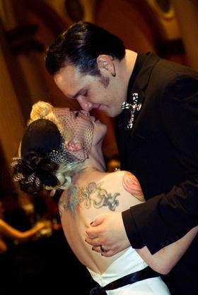 Brandon Saller, drummer of Atreyu, with bride in an Alvina Valenta dress and black wedge veil
